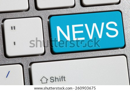 News button on a computer keyboard. - stock photo
