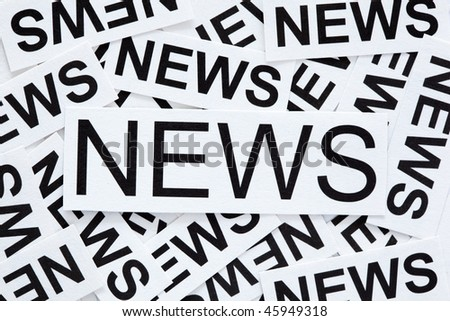 News concept. Many paper labels with the word NEWS. - stock photo