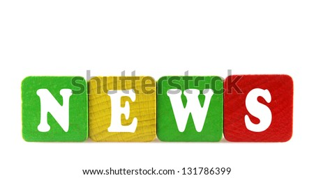 news - isolated text in wooden building blocks - stock photo