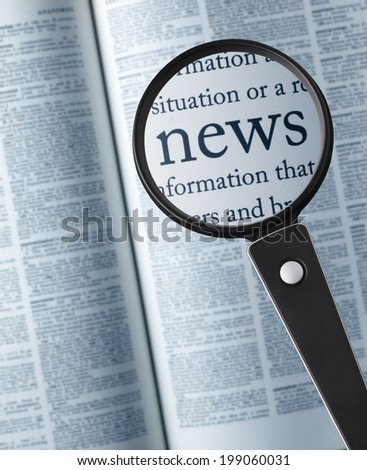 """news/Magnifying glass on the""""news"""" in dictionary - stock photo"""