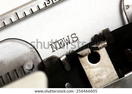 News, News written on an old typewriter - stock photo