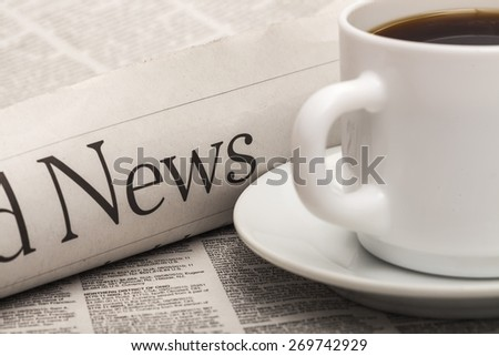 News. Newspaper and coffee cup macro shot with shallow depth of field - stock photo