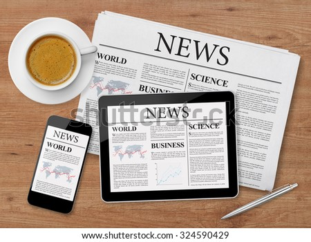 News page on tablet, mobile phone and newspaper - stock photo