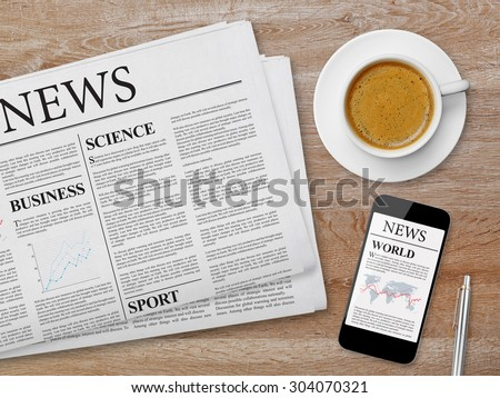 News page on tablet, newspaper and coffee - stock photo