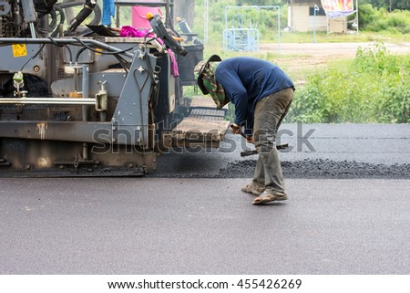 News Tao Ngoi, Sakon Nakhon, Thailand July 20, 2016. Road construction. Workers are asphalt.