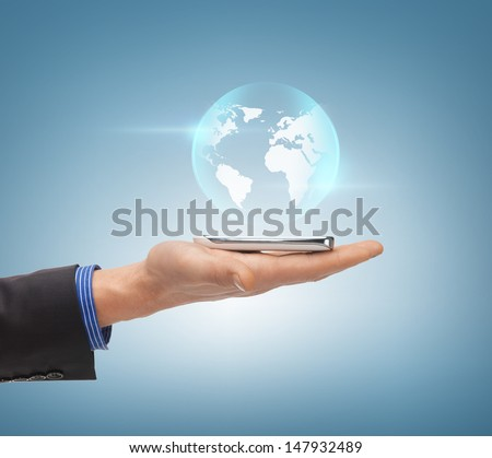 news, technology and environment concept - man hand with sphere globe - stock photo