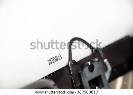 News text on retro typewriter - stock photo