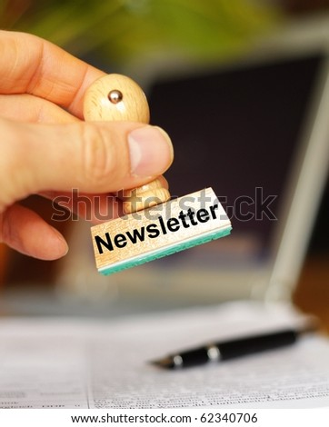 newsletter concept with stamp in office showing news concept