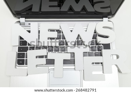 newsletter letters on keyboard of laptop - stock photo