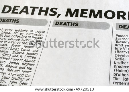Newspaper advertisement displaying obituaries. - stock photo