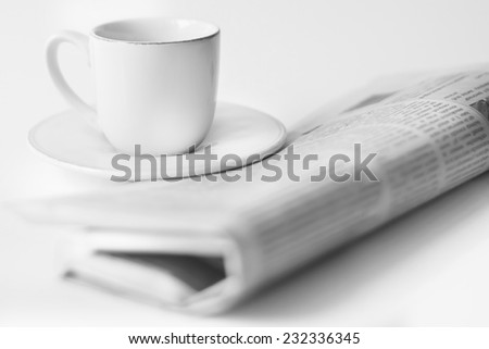 newspaper and a cup of coffee on a white background - stock photo