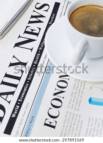 Newspaper and coffee - stock photo
