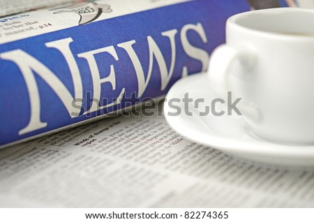 Newspaper and coffee cup macro shot with shallow depth of field - stock photo