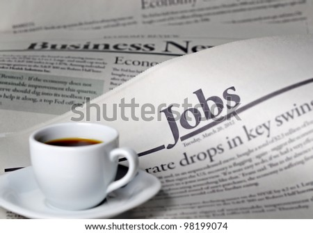 Newspaper and coffee with shallow depth of field