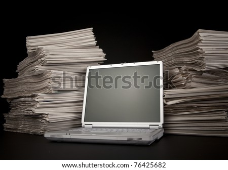 Newspaper and Laptop - stock photo