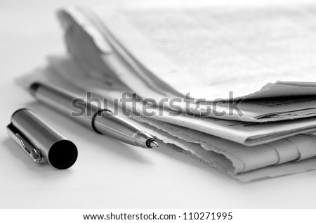 Newspaper and news accounts to handle - stock photo