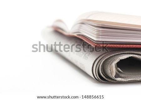 Newspaper and Note pad.Message on Copy space.