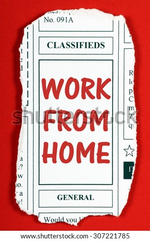 Newspaper clipping from the classified advertising section with the phrase Work From Home in red text. Clipping made in MSword by the photographer - stock photo