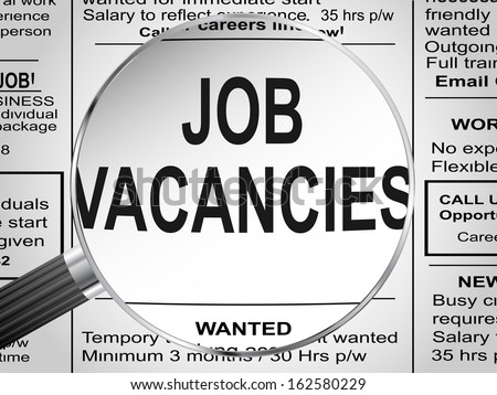 Newspaper clipping. Jobs vacancies under magnifying glass - stock photo