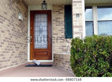 Newspaper Delivered To Front Door - stock photo