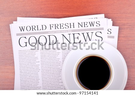 Newspaper GOOD NEWS and cup of coffee top view - stock photo