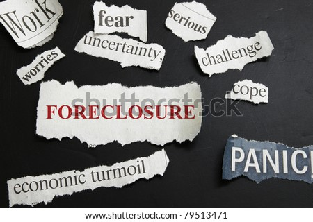 Newspaper headlines showing Foreclosure and bad economic news - stock photo