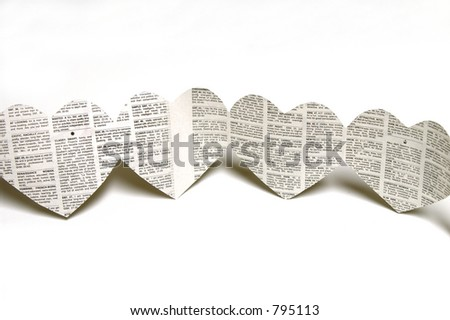 Newspaper Heart Shaped Cutouts - stock photo