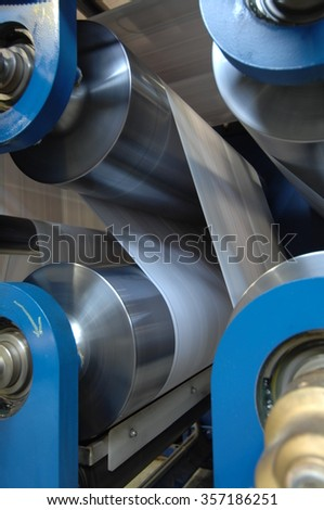 Newspaper offset printing machine.Kuwait.The print edition of the newspaper. - stock photo