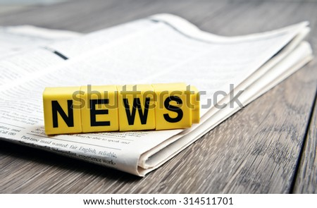 newspaper on table - stock photo