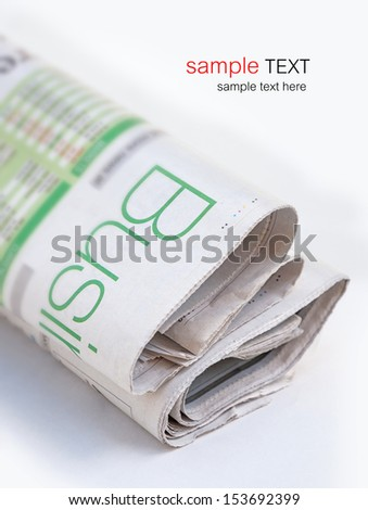 Newspaper on white background with shallow depth of field - stock photo