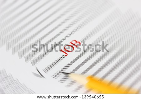 Newspaper opened to want ads, close up - stock photo