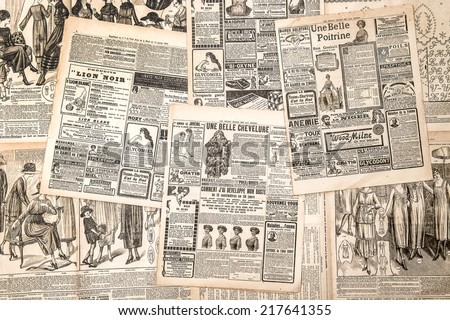Newspaper pages with antique advertising. Woman's fashion magazine Le Petit Echo de la Mode from 1919 - stock photo