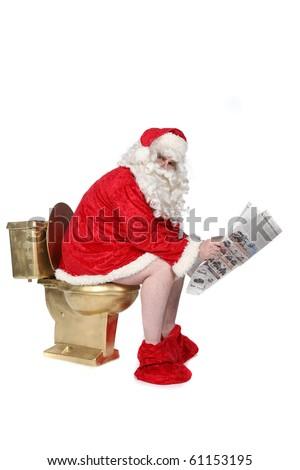 Newspaper reading Santa sitting on golden toilet - stock photo