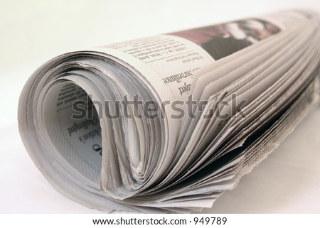 Newspaper rolled up - stock photo