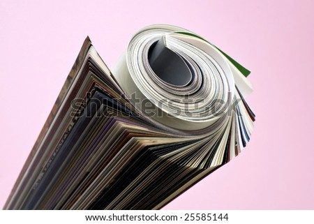 Newspaper rolled up background isolate. - stock photo