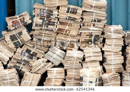 Newspaper stack. Huge pile of old magazines in the backyard - stock photo