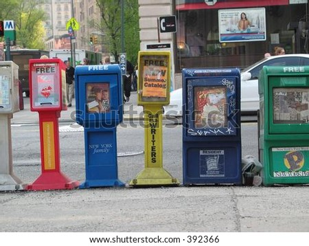 Newspaper stands on the street in NYC - stock photo