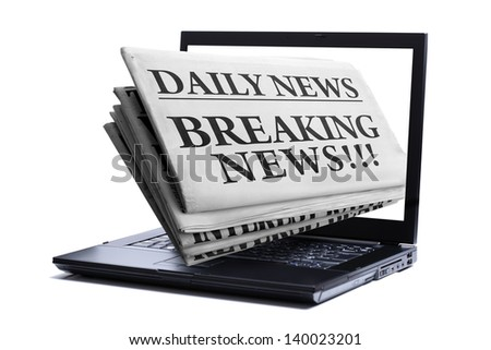 Newspaper through a laptop screen  concept for latest online news - stock photo