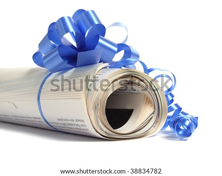 Newspaper with bow - stock photo