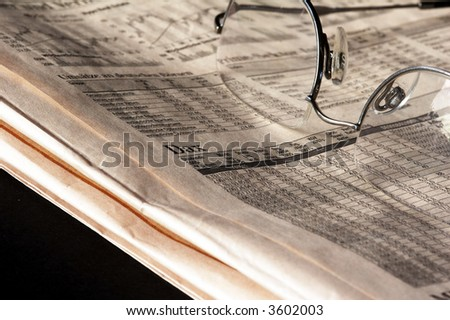 Newspaper with German Stock Market and glasses - stock photo