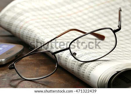 newspaper with stock quotations