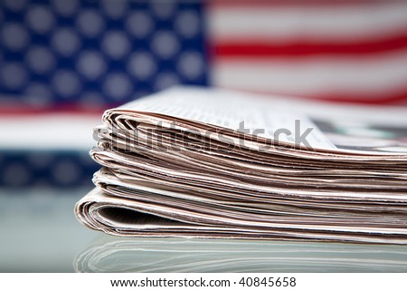 Newspapers before ensign of the USA