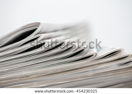 Newspapers folded and stacked.