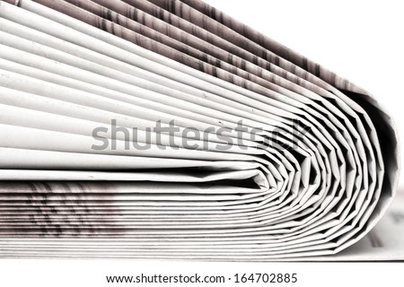 Newspapers folded and stacked concept for global communications - stock photo