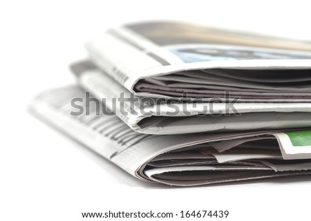Newspapers folded, conceptual image for global communications - stock photo