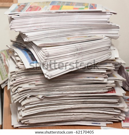 Newspapers isolated on desktop - stock photo