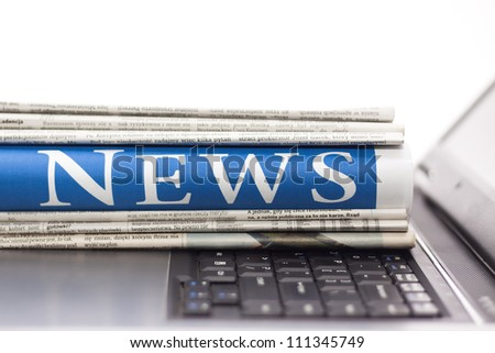 Newspapers on the laptop. Online news. Isolated on white. - stock photo