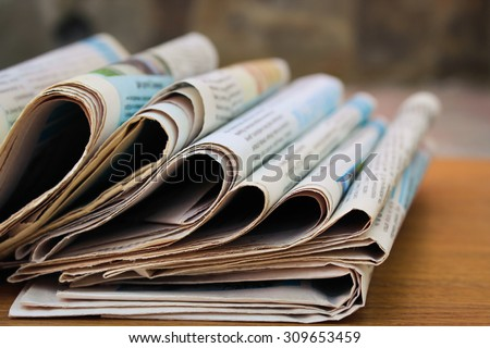 Newspapers on the table - stock photo