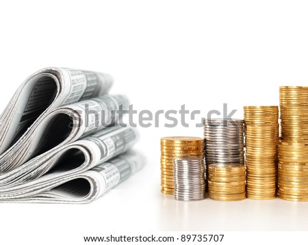 newspapers with stack of coins, business concept - stock photo