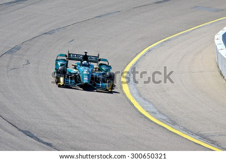 Newton, Iowa USA - July 17, 2015: Verizon IndyCar Series Iowa Corn Indy 300. 20 Ed Carpenter Indianapolis, Ind. Fuzzy�¢??s Vodka CFH Racing Chevrolet CFH Racing. Practice session on track.